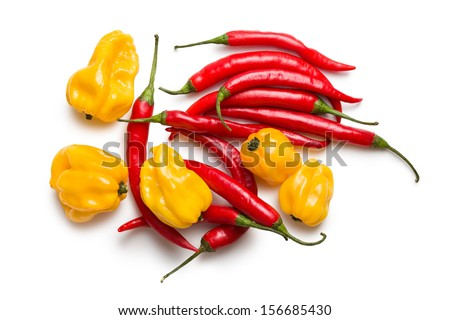 top view of red chili peppers and yellow habanero on white background - stock photo