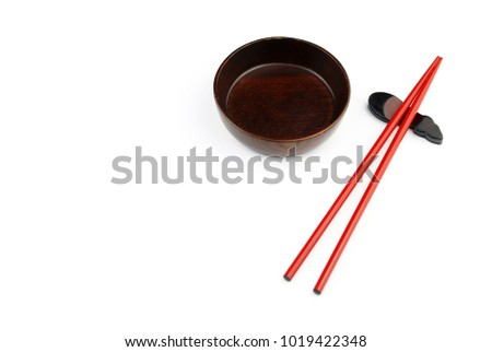 Top view of red chopsticks and Wood bowl on white background.Flat lay Copy space