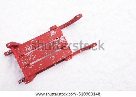 Top view of red sled in the snow