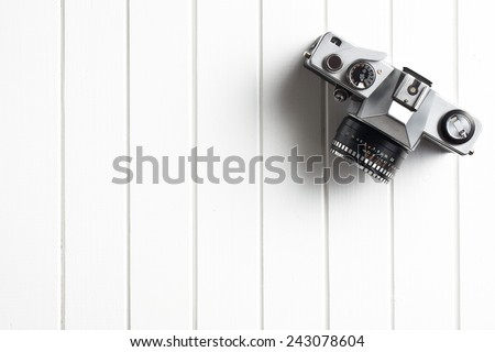 top view of retro camera on wooden table - stock photo