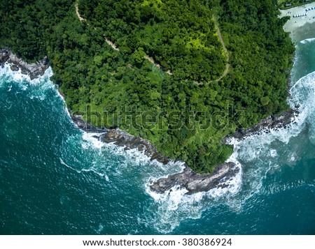 Top View of Rocks in Camburi Beach, Sao Paulo, Brazil - stock photo