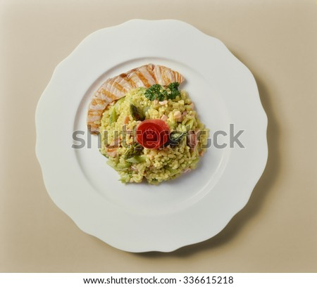 Top View of Salmon and Asparagus Risotto - stock photo