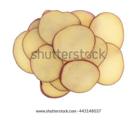 Top view of several slices of red potatoes isolated on a white background.