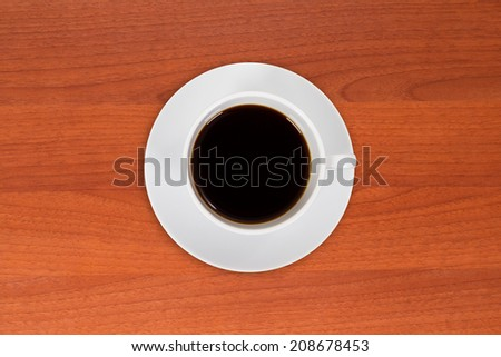 Top view of single coffee or tea on wooden table.