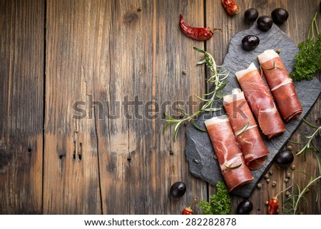 Top view of sliced prosciutto with space for your text - stock photo