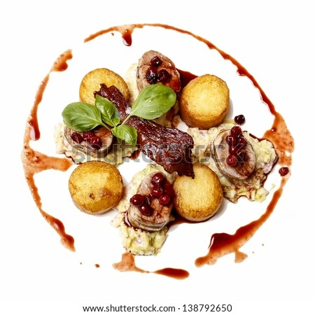 Top view of sliced roasted beef with potatoes and cranberries - stock photo