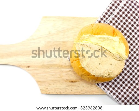 top view of slices bread with butter on a rustic wooden cutting board wooden background