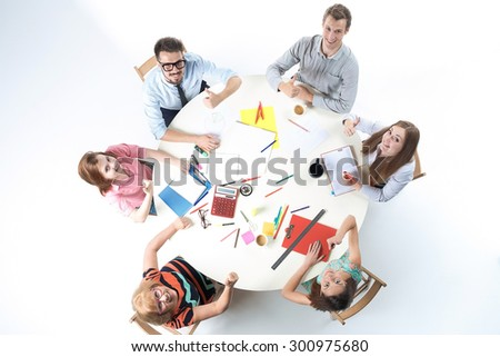 Top view of smilimg business team, sitting at a round table on white background.  concept of success - stock photo