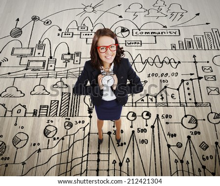 Top view of smiling businesswoman holding alarm clock
