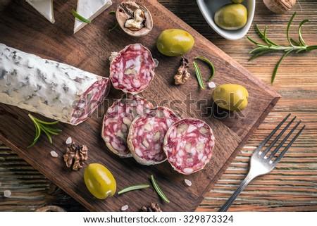 Top view of smoked sausage salami with walnut - stock photo