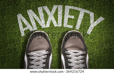Top View of Sneakers on the grass with the text: Anxiety