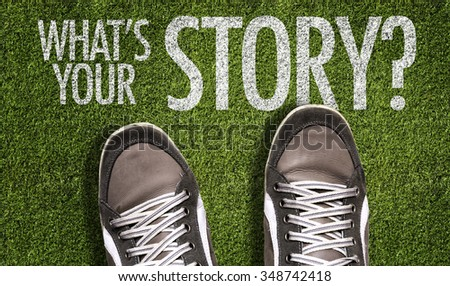 Top View of Sneakers on the grass with the text: What's Your Story? - stock photo
