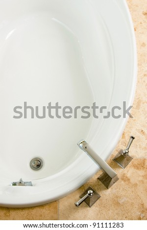 Top view of soaking tub in stone surround