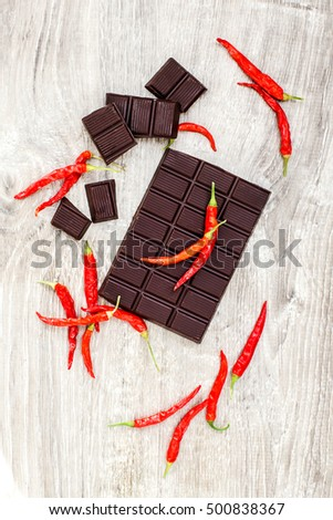 top view of spicy dark chocolate over white wood