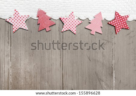 Top view of star and pine tree decoration with crochet strip on wooden background for christmas - stock photo