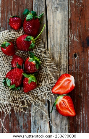 Top view of strawberries on Wooden Background. Summer or Spring Organic Berry over Wood. Agriculture, Gardening, Harvest Concept.  - stock photo