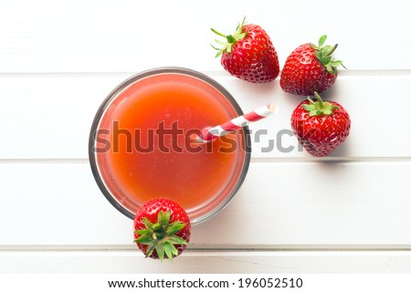 top view of strawberry juice in glass - stock photo