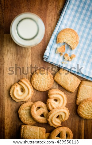 Top view of sweet biscuits and fresh healthy milk.