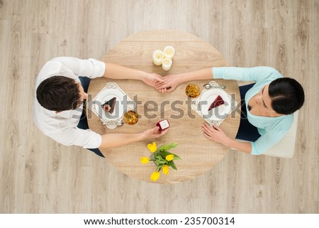 Top view of table with couple - stock photo