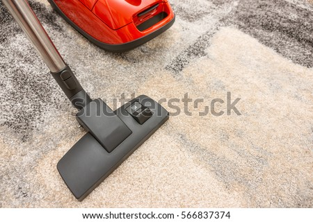 Top View Of The Head A Modern Vacuum Cleaner Being Used While Vacuuming Carpet