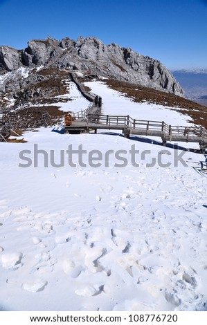 Top view of the high mountain covering with snow - stock photo