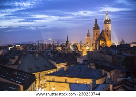 Top view of the rooftops of the old town of Krakow at night. - stock photo