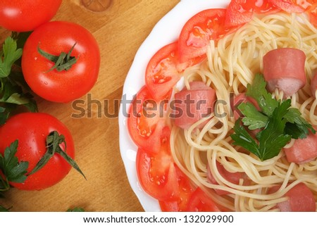 Top view of the spaghetti with sausage - stock photo