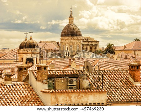 Top view  of the traditional ceramic roof housesof in  old quarter of Dubrovnik, Croatia.,In the center of the image is a Catholic Cathedral - stock photo