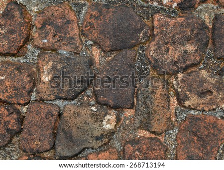 Top view of the unusual brick paving texture. - stock photo