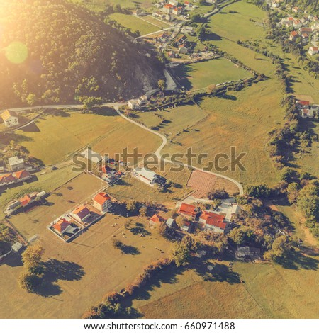 Top view of the village houses with red tiled roof. Toned