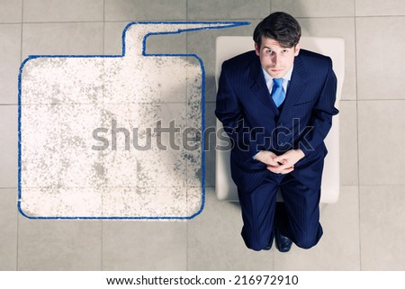 Top view of thoughtful businessman sitting on chair