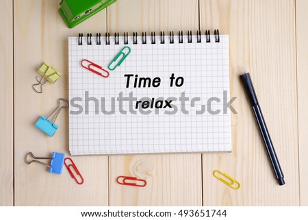 Top view of Time to relax on notebook on wood table background concept. Decorated and blank space.