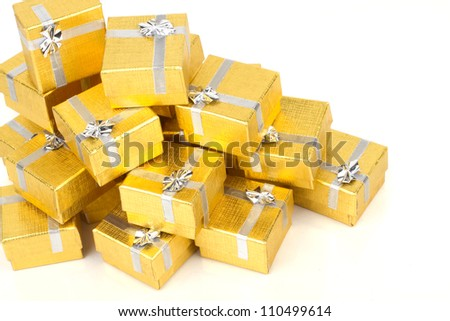 Top view of towel of gold gift boxes on white background - stock photo