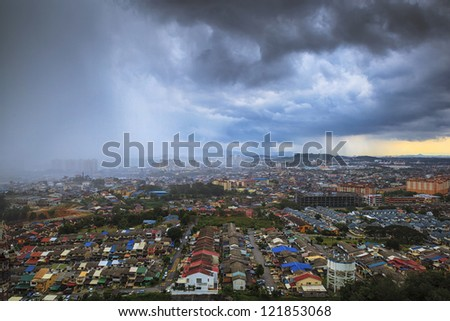 Top view of town at rain is coming - stock photo