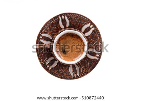 Top view of traditional cup of Turkish coffee with foam, isolated on white background.
