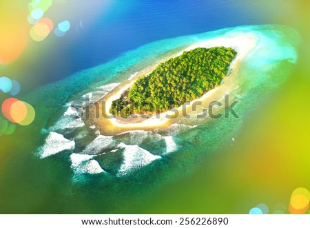 Top view of tropical island in turquoise blue water. Maldives panoramic landscape. Retro style toned picture with light leaks and lens flares - stock photo