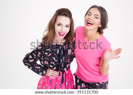 Top view of two cheerful attractive young women laughing over white background - stock photo