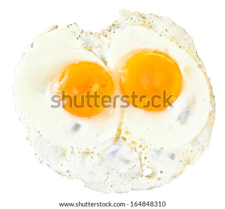 top view of two fry eggs isolated on white background
