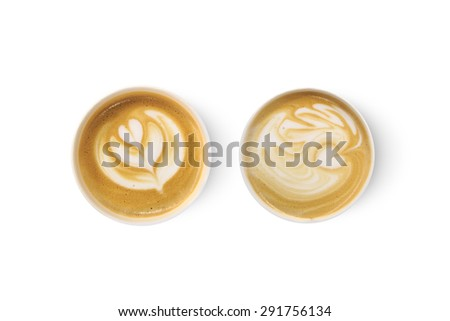Top view of two latte art coffees with heart figure, isolated on white background. - stock photo