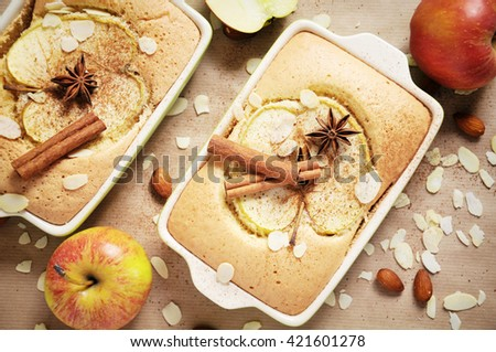 Top view of two portions homemade apple cake on a paper background, baking concept, closeup - stock photo