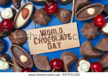 top view of various chocolate pralines, chocolates of different shapes and kinds. text World Chocolate Day  - stock photo