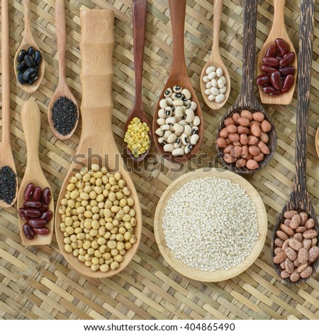 Top view of various leguminous and white sesame with a wooden cookware, Flat lay - stock photo