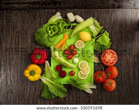 top view of vegetables on wooden background - stock photo