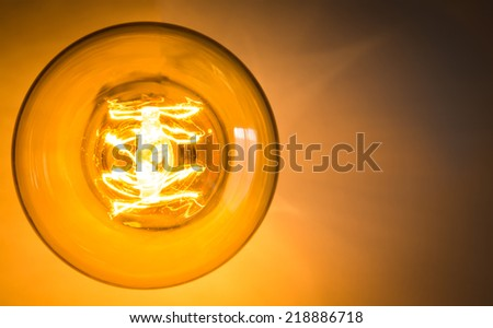 Top view of vintage glowing light bulb - stock photo