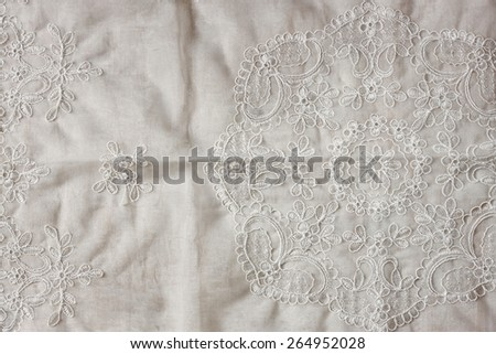 top view of vintage hand made beautiful lace fabric over wooden table - stock photo