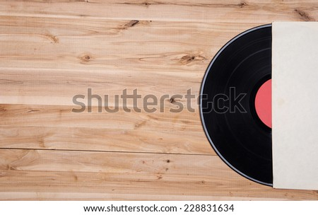 top view of vinyl record over wooden table