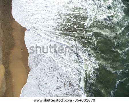 Top View of Waves in a Beach - stock photo
