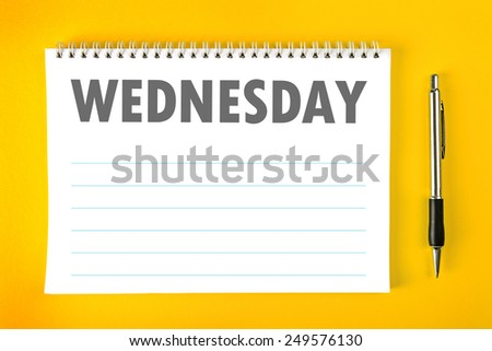 Top View of Wednesday Paper Calendar Blank Page with Spiral Binding as Time Management and Schedule Concept. - stock photo