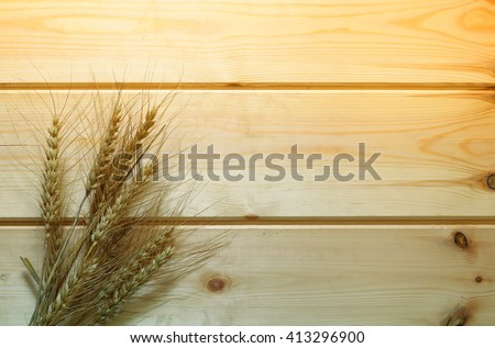top view of whet crop on wooden table. vintage filtered image. Symbols of jewish holiday - Shavuot  - stock photo