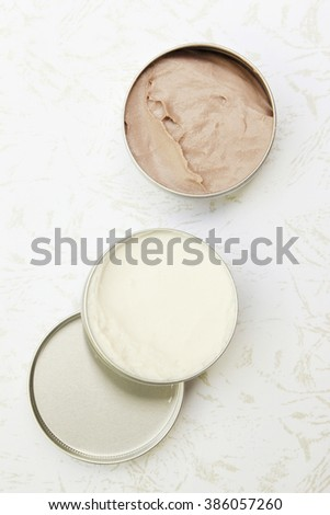 Top view of white and brown beauty creams - stock photo